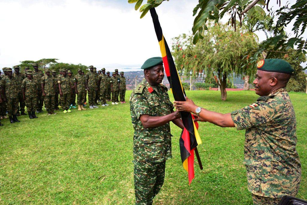 Maj Gen Joseph Musanyufu hands Uganda flag to UPDF team head